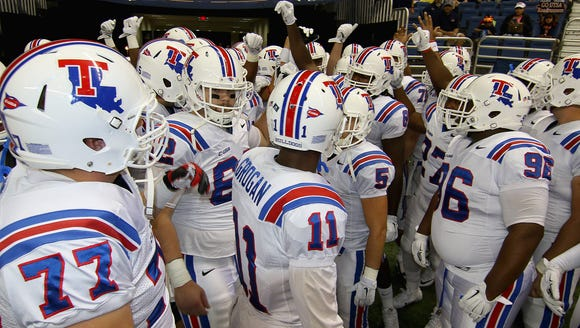 Louisiana Tech players huddle before the UTSA game