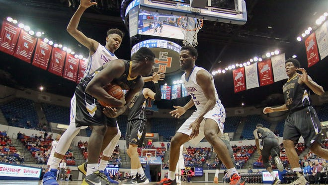 Louisiana Tech players Jy'lan Washington, left, and Erik McCree, right, trap a Southern Miss during the Conference USA opener in Ruston.