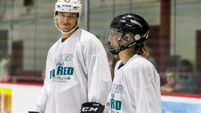 Dustin Brown and his wife, Nicole, pictured at last year's Racker Center game.