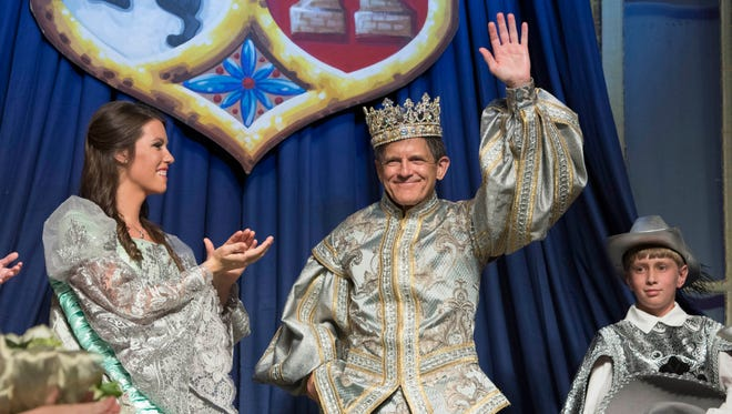 Fiesta Queen 2016 Elizabeth McIver Major applauds as Don Tristan de Luna LXVII, Dr. Robert Frost Patton, waves to the audience during last year's Fiesta of Five Flags Coronation Ball at the Pensacola Bay Center. This year's ball is Friday.