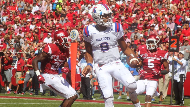 Louisiana Tech quarterback J'Mar Smith spoke Friday for the first time about juggling football and baseball.
