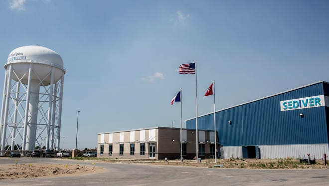 September 29, 2016 - The French national, American national and Arkansas state flags fly in front of Sediver's under-construction facility on Thursday afternoon. Sediver has nearly completed its $15 million plant that will make glass insulators for transmission lines. The plant marks the return of Sediver manufacturing to the U.S. over their sites in China and Europe. The company chose West Memphis because of Memphis logistics advantages and in anticipation of the major new transmission line that's planned to be built from Oklahoma, across northern Arkansas. 