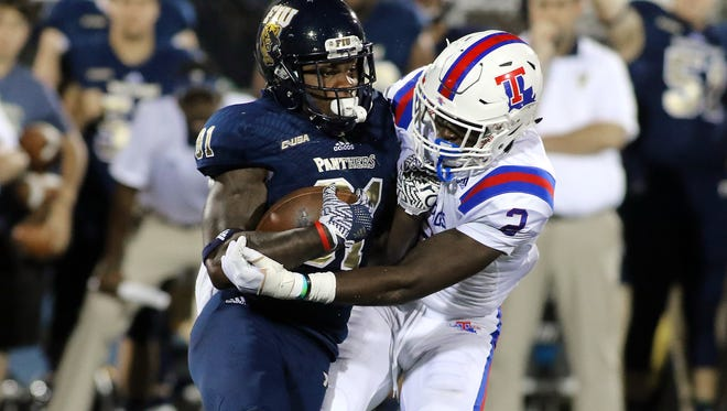 Secdrick Cooper, right, who started the year at safety for Louisiana Tech, has moved back there after spending a few weeks at linebacker.
