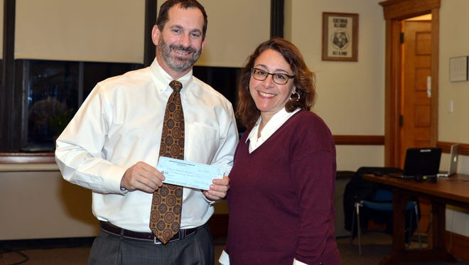 Ridgewood, NJ 12/5/16   Mary Micale (right), President of the Ridgewood Education Foundation presenting to Dr. Daniel Fishbein (left) a donation from the REF  in the amount of $62,500 to Ridgewood Schools.