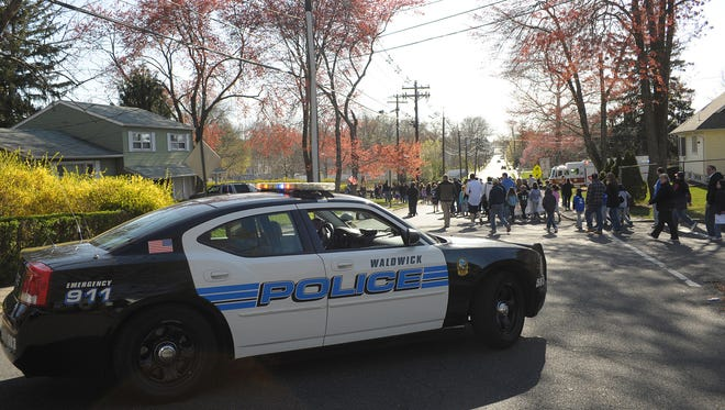 Waldwick police close the streets for the town's Little League opening day parade in this 2012 photo.