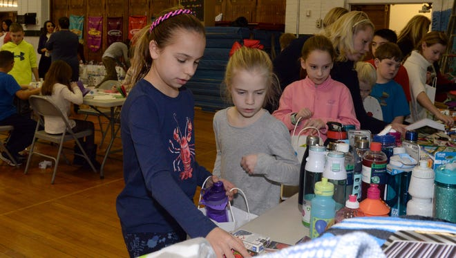 Ridgewood 02/13/17   Day of service at Willard Elementary School in Ridgewood.Elisabeth (left) and Alexandra loading bags with items for cancer patients at Valley Hospital.