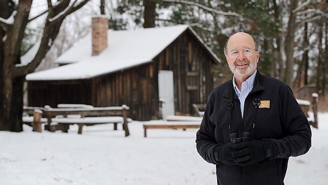 Binoculars at the ready, Stan Temple, University of Wisconsin-Madison emeritus professor of forest and wildlife ecology and senior fellow at the Aldo Leopold Foundation, is pictured in the snowy woods near the historic Aldo Leopold Shack in rural Baraboo, Wis., during winter on Dec. 6, 2010.