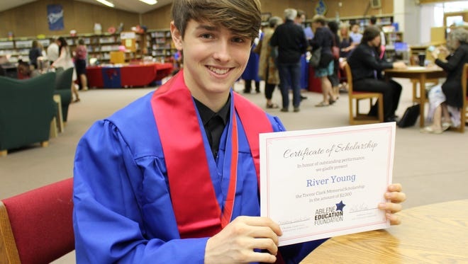 River Young, who'll graduate Saturday from Cooper High School, holds a certificate for a $2,000 Trevor Clark Memorial Scholarship.