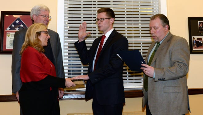 Bill Leonard Jr. is sworn in to the Glen Rock Borough Council in January by Mayor Bruce Packer, right. His parents, Bill Leonard Sr. and  Anne Marie Leonard, hold the Bible.