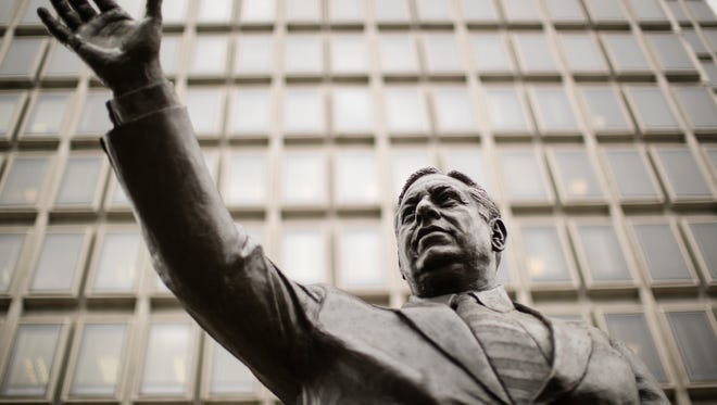 This Aug. 15 file photo shows a statue of late Philadelphia Mayor Frank Rizzo, who also served as the city's police commissioner, on Thomas Paine Plaza outside the Municipal Services Building in Philadelphia. Philadelphia will move the statue from its location in the shadow of City Hall, the city announced in a statement. A new site for the statue has not been announced.
