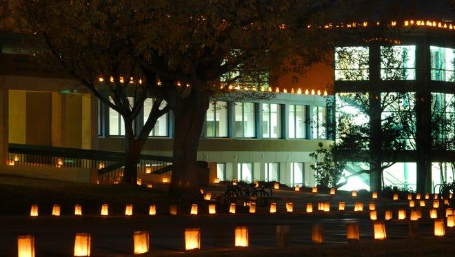 Luminarias line campus walkways near Corbett Center during the 2008 annual Noche de Luminaria event