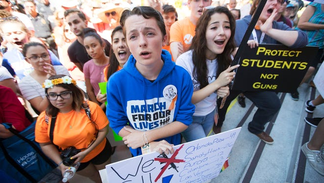 Donovan Souppa, 15, center, and Yuliana Garcia, 16, right, of North Fort Myers High School, were among the more than 1,000 people that attended the March for Our Lives rally on Saturday in downtown Fort Myers, Florida.