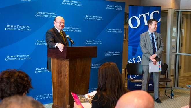 Hal Higdon, chancellor of Ozarks Technical Community College and Matt Simpson, the college's director of research, strategic planning and grant development, unveil the college's five-year strategic plan.