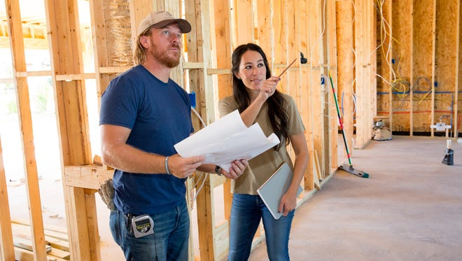 "Joanna Gaines and husband Chip check in on the progress of a home on ""Fixer Upper."""