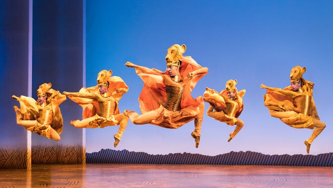"""The elaborate costumes, face make-up and masks are beautiful and captivating in Disney's """"The Lion King."""""""