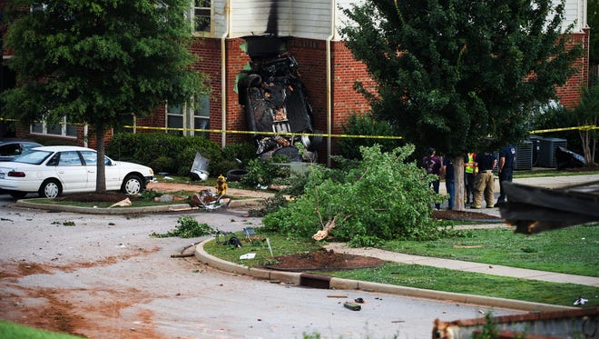 Law enforcement officers and Parker District Fire Department respond to the site of a police chase that ended in a vehicle crash at Parker at Cone apartment complex on Tuesday, July 18, 2018.