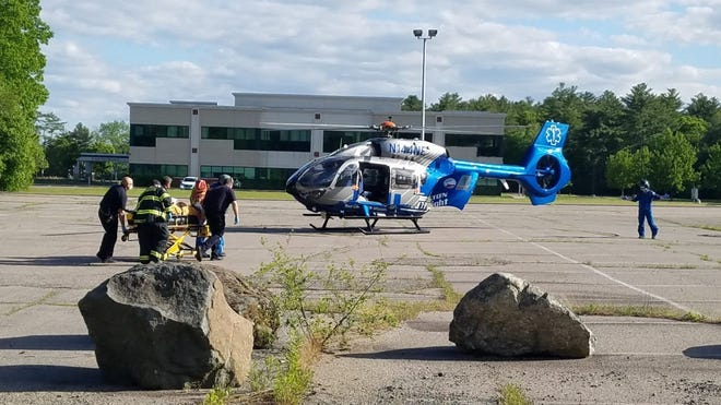 A motorcyclist involved in a collision with an SUV was taken by an East Bridgewater ambulance to a nearby landing zone where a medical helicopter soon arrived to take him to a Boston hospital, Sunday, June 1, 2020.