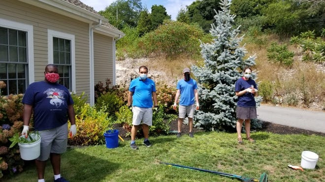 Members of the Launch Cohasset team recently cleaned up the grounds of the Cohasset Elder Affairs building at Willcutt Commons.