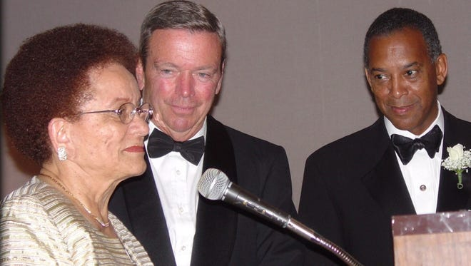 Sybil Mobley,left, with former Anheuser Busch chairman August Busch III, center, and Microsoft Chairman John Thompson at her retirement gala in 2003.