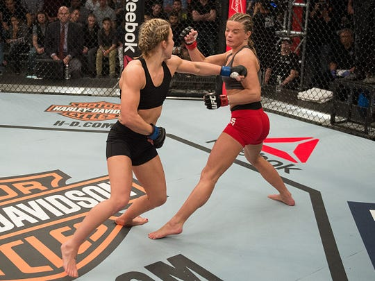 """Amanda Cooper punches Mellony Geugjes during """"The Ultimate Fighter"""" elimination fights at the UFC TUF Gym on January 26 in Las Vegas."""
