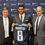 May 1, 2015; Nashville, TN, USA; Tennessee Titans first round draft pick Marcus Mariota (C) stands with executive vice president and general manager Ruston Webster (L) and head coach Ken Whisenhunt (R) during the press conference at Saint Thomas Sports Park. Mandatory Credit: Jim Brown-USA TODAY Sports