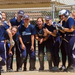 The Great Falls High softball team welcomes senior Hannah Schaffer to home plate after her home run Thursday against Kalispell Glacier at the State AA tournament in Missoula.