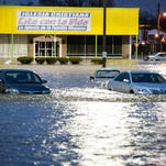 Several parked cars in a lot on Preston Highway sit submerged by the flash flooding April 3.