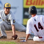 Matt Garcia of the Great Falls Chargers, left, prepares to tag out Bozeman Bucksâ?? baserunner Michael Guenther (14) Saturday during the Chargersâ?? 18-10 win over the Bucks in Bozeman. BOZEMAN CHRONICLE/ADRIAN SANCHEZ-GONZALEZ