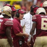 Florida State's head coach Jimbo Fisher, center, knows that the Wake Forest game is one that the Seminoles can't afford to lose.