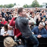Atreyu lead singer Alex Varkatzas drops into the photo pit for an up close performance for the fans at Louder Than Life on Saturday. 10/3/15
