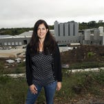 New Belgium Brewing Co. CEO Christine Perich stands for a picture on a hill overlooking the company's new East Coast brewery along the banks of the French Broad River Tuesday morning in Asheville, North Carolina.