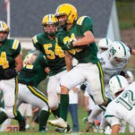 Burlington quarterback Peter LaBracio (7) throws a pass during the football game between the Burlington Seahorses and the Rice Green Knights at Rice Memorial High School on Saturday September 5, 2015 in South Burlington, Vermont. (BRIAN JENKINS/for the FREE PRESS)