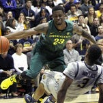 Feb 25, 2015; Berkeley, CA, USA; Oregon Ducks forward Elgin Cook (23) ) charges California Golden Bears guard Tyrone Wallace (3) in the first half of their NCAA basketball game at Haas Pavilion. Mandatory Credit: Lance Iversen-USA TODAY Sports