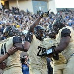 Vanderbilt safety Oren Burks (20) celebrates his interception return for a touchdown against Kentucky in 2015. He has moved to the Star position in spring practice.