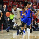 Ole Miss guard Donte Fitzpatrick-Dorsey (20) brings the ball up court against Florida last month. The freshman credits the impact former coach Desmond Merriweather, who died last February, had on his reaching Ole Miss.
