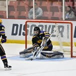 University of Wisconsin-Stevens Point's Tanner Karty beats SUNY Geneseo goalie Devin McDonald for a goal in the first period Friday in the Pointers' 5-1 win over SUNY Geneseo in semifinal action at the Division III Frozen Four at Herb Brooks Arena in Lake Placid, N.Y.