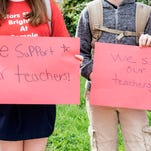 Students held handmade signs to show support for their teachers during a Monday morning walk-in at Semple Elementary. 5
