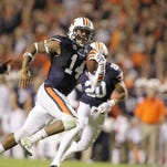 Auburn quarterback Nick Marshall (14) scores a touchdown against South Carolina on Saturday night. Marshall ran for three touchdowns in the 42-35 win.