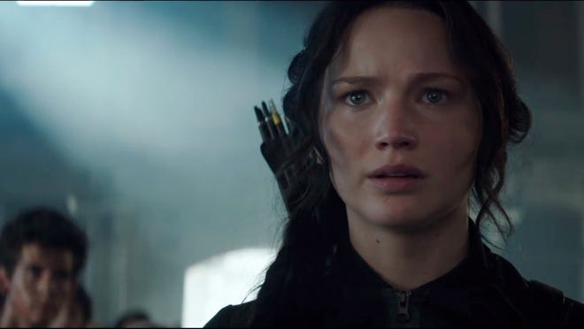 """Screen grab of youtube video '""""Our Leader the Mockingjay"""" – Official Teaser Trailer' Pictured: Jennifer Lawrence as Katniss Everdeen Web to Watch - The Hunger Games: Mockingjay Part 1 - Teaser Trailer Channel: The Hunger Games on YouTube Jennifer Lawrence is not messing around in the first trailer for The Hunger Games: Mockingjay Part 1. The teaser debuted at San Diego's Comic-Con but is now available online. youtube.com/TheHungerGamesMovie [Via MerlinFTP Drop]"""