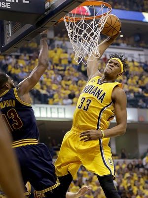 Indiana Pacers center Myles Turner (33) slams the ball down over Cleveland Cavaliers center Tristan Thompson (13) in the first half  of their NBA playoff game Thursday, April 20, 2017, evening at Bankers Life Fieldhouse.