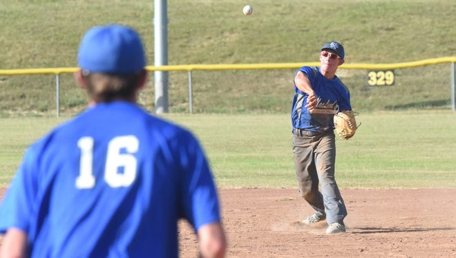 Mountain Home MacLeod second baseman Clayton Jones throws to first for an out Tuesday at Salem.