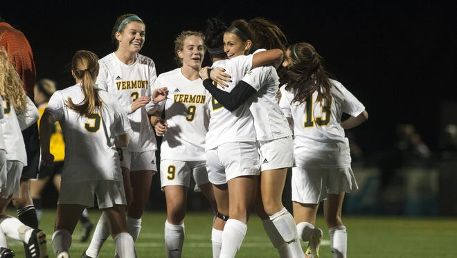 Vermont players celebrate a goal by Dana Buckhorn, right, in the first half of Thursday night's America East playoff game against UMBC at Virtue Field.