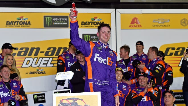 Denny Hamlin celebrates with his team after winning Can-Am Duel No. 2 Thursday at Daytona International Speedway.