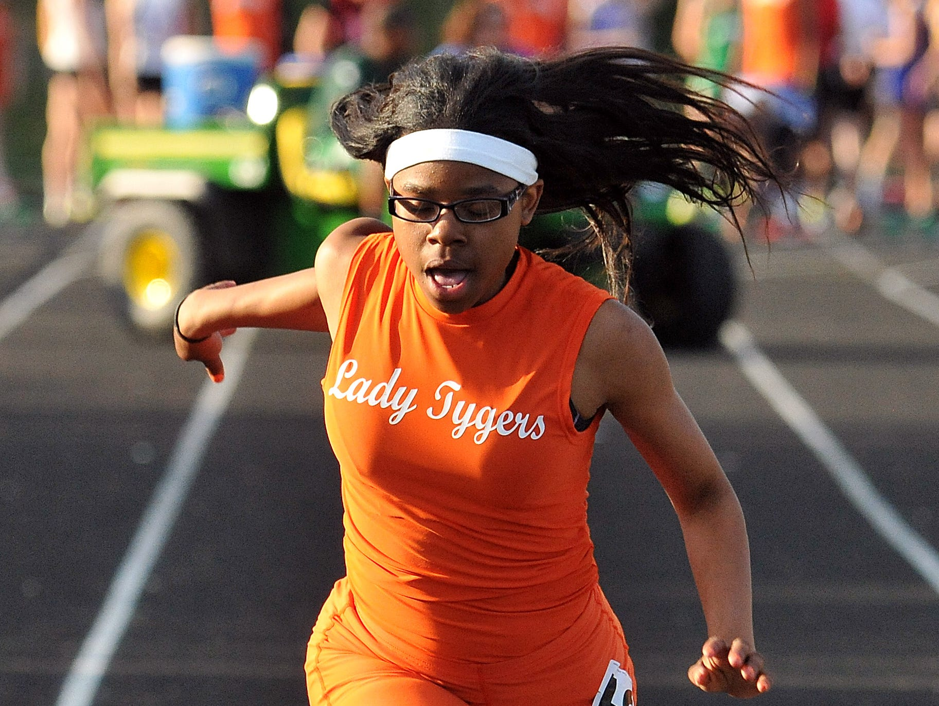 Mansfield Senior's Alaya Grose crosses the finish line during the girls 100 Meter Dash at Madison High School Friday.