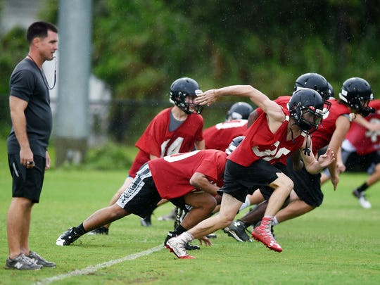 South Fork High School head football coach Mike Lavelle looks on as his players run through conditioning drills on the first day of practice, Monday, July 31, 2017, at the high school. South Fork begins their regular season schedule against Jensen Beach on Aug. 25.