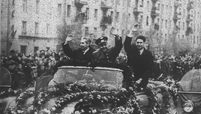 Cosmonaut Vladimir Komarov (center), during a 1964 celebration in Moscow, was killed in 1967 when his Soyuz 1 spacecraft smashed into the Earth after his parachutes failed to deploy properly during re-entry; he was the first human spaceflight fatality.