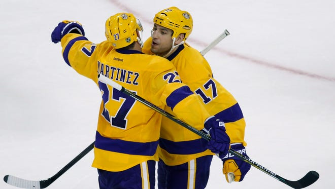 Kings left wing Milan Lucic celebrates with defenseman Alec Martinez after defeating the Bruins 9-2 at TD Garden.