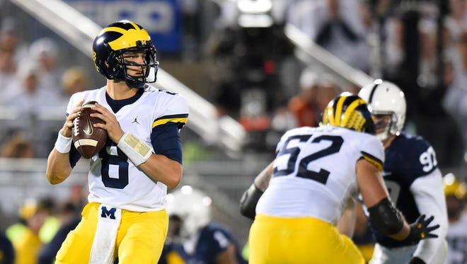 Michigan Wolverines quarterback John O'Korn.