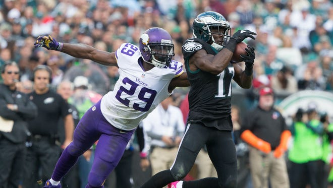 Philadelphia Eagles wide receiver Nelson Agholor (17) makes a reception past Minnesota Vikings cornerback Xavier Rhodes (29) during the first half at Lincoln Financial Field.