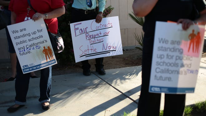 About a hundred educators with the Coachella Valley Teachers Association and some students gathered outside the Coachella Valley Unified School District office to support their negotiators as they work to get a better contract with district on Wednesday, November 9, 2016 in Thermal.